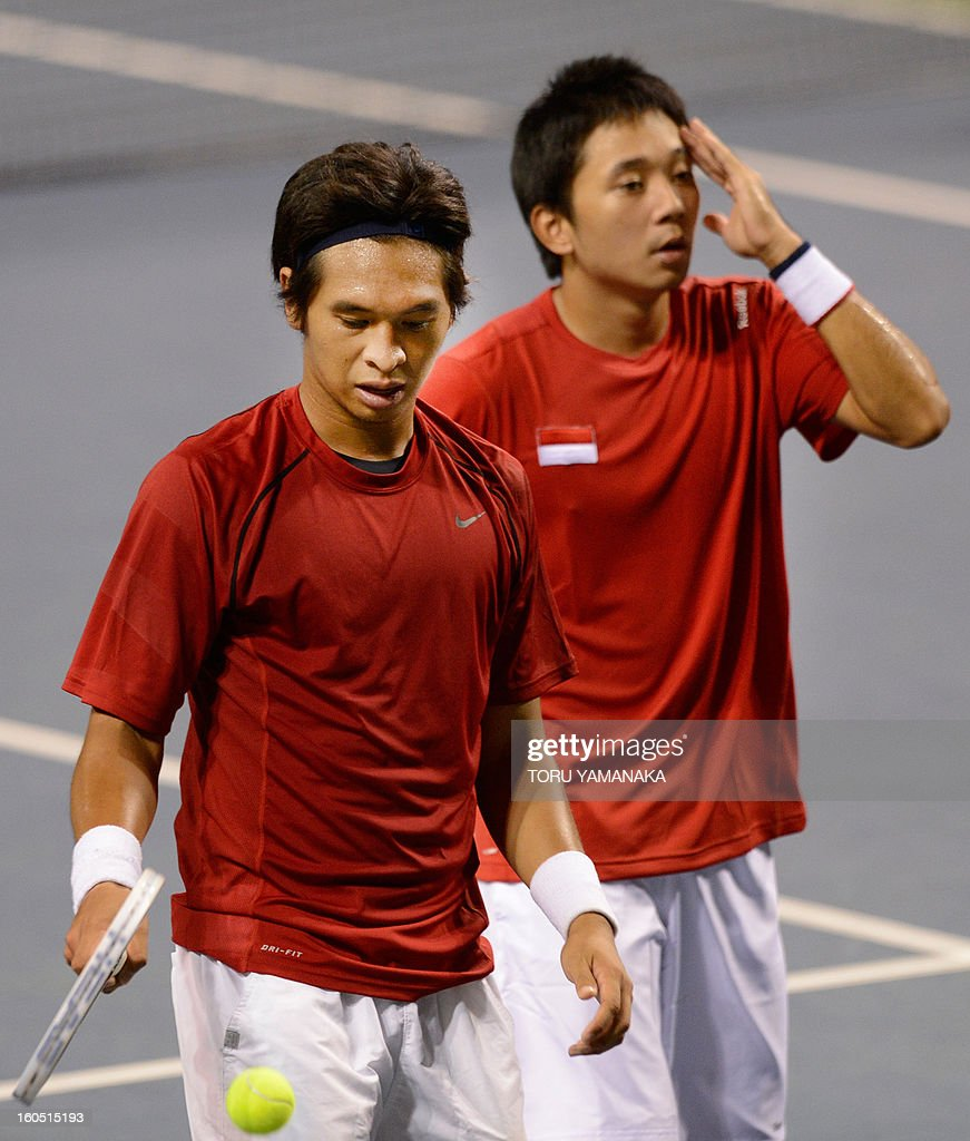Indonesia's Christopher Rungkat (L) and his partner Elbert Sie (R) reactaftet they lost a point against Japan's Tatsuma Ito and Yasutaka Uchiyama during their men's doubles tennis match at the Davis Cup Asia-Oceania Zone Group I first-round tie on February 2, 2013. Japanese pair won Indonesian pair 6-4, 5-7, 2-6, 7-5, 6-2. AFP PHOTO/Toru YAMANAKA