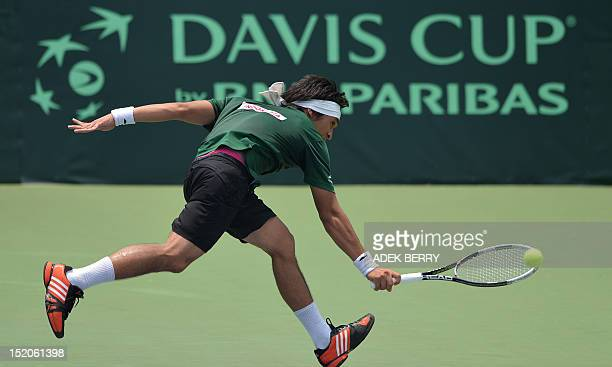 Indonesia's Christopher Rungkat plays a shot during his victory against Jeson Patrombon of the Philippines in the final round of the men's Davis Cup...