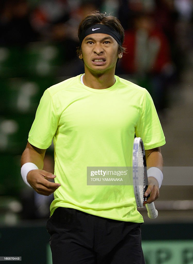 Indonesia's Christopher Rungkat reacts while playing against Japan's Yuichi Sugita during their men's singles match at the Davis Cup Asia-Oceania Zone Group I first-round tie tennis tournement in Tokyo on February 3, 2013. AFP PHOTO/Toru YAMANAKA
