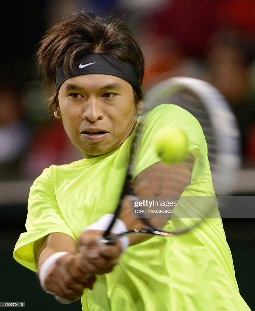 Indonesia's Christopher Rungkat returns a shot against Japan's Yuichi Sugita during their men's singles match at the Davis Cup Asia-Oceania Zone Group I first-round tie tennis tournement in Tokyo on February 3, 2013. AFP PHOTO/Toru YAMANAKA