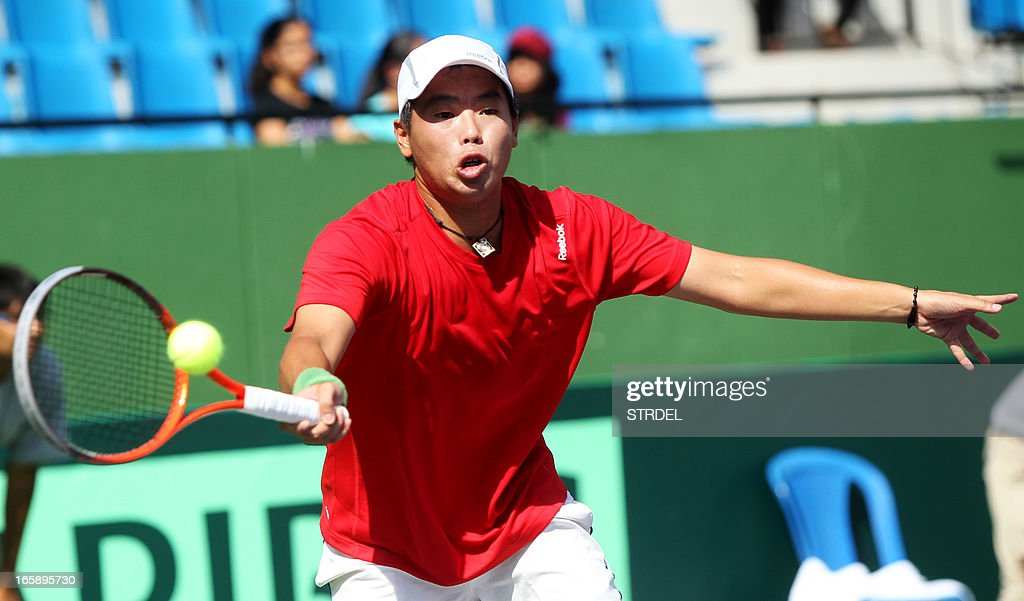 Indonesia's David Agung Susanto plays a shot against India's Somdev Devvarman during the Asia/Oceania Zone Group I Davis Cup singles play-off match at KSLTA stadium in Bangalore on April 7, 2013.