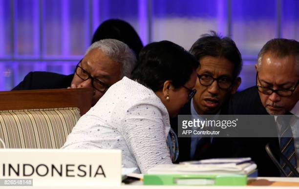 Indonesia's Foreign Minister Retno Marsudi talks to her staff during a meeting of the 50th Association of Southeast Asian Nations Foreign Ministers...