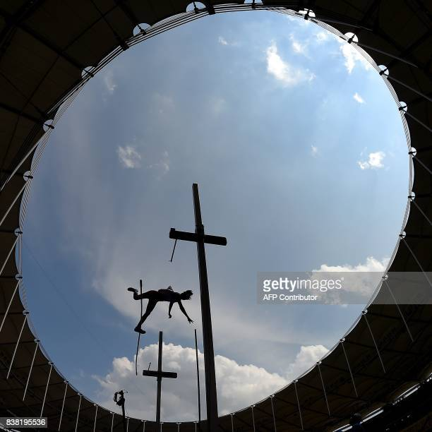 Indonesia's Fredrick Saputra competes in the men's polevault athletics final of the 29th Southeast Asian Games at the Bukit Jalil national stadium in...