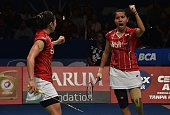 Indonesia's Greysia Polii and Nitya Krishinda Maheswari celebrate a point against China's Yu Yang and Zhong Qianxin during their women doubles...