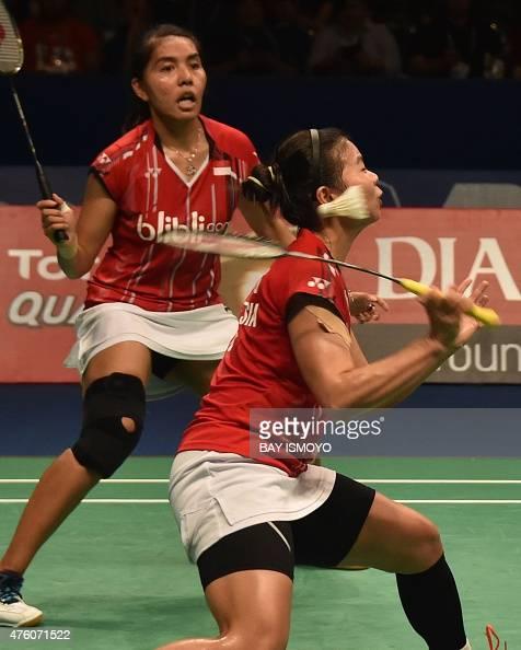 Indonesia's Greysia Polii hits a return while partner Nitya Krishinda Maheswari looks on against China's Yu Yang and Zhong Qianxin during their women...