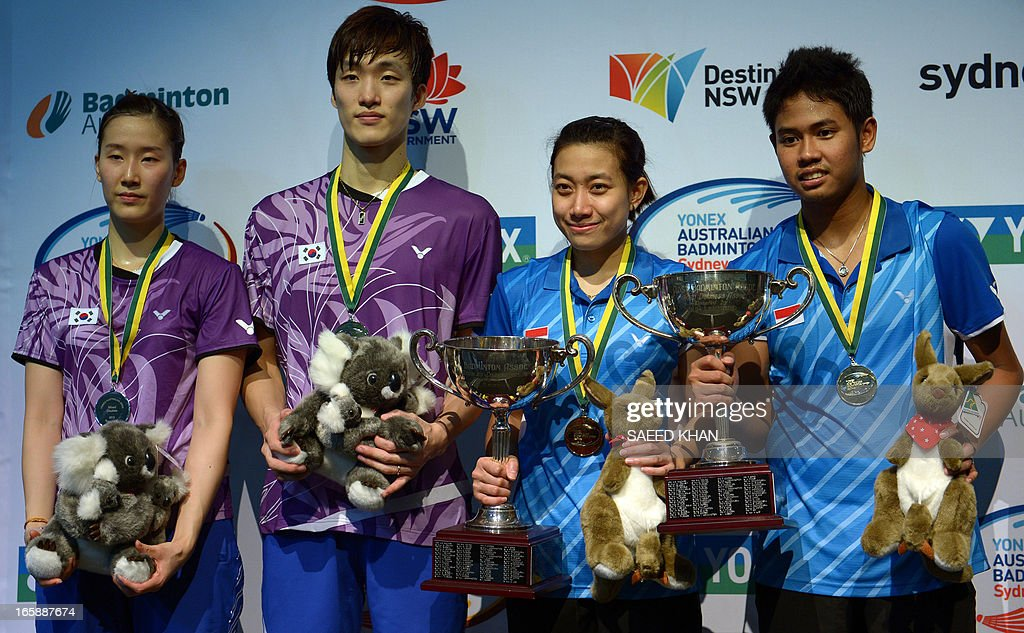 Indonesia's Irfan Fadhilah (R) and Weni Anggraini (2nd R) pose for pictures with the winner's trophy along with runners-up Shin Baek Choel (2nd L) and Jang Ye Na (L) of South Korea after their mixed doubles final at the Yonex Australian Badminton Open in Sydney on April 7, 2013. AFP PHOTO / Saeed KHAN USE
