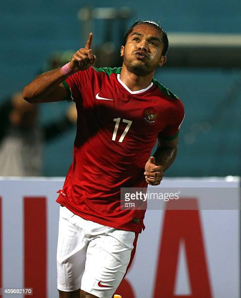 Indonesia's Malik Zamrun celebrates after scoring a goal during an AFF Suzuki Cup match against Laos at Hanoi's Hang Day stadium on November 28 2014...