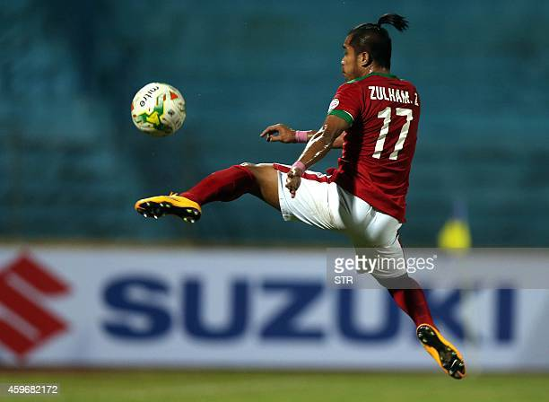 Indonesia's Malik Zamrun controls the ball during an AFF Suzuki Cup match against Laos at Hanoi's Hang Day stadium on November 28 2014 Indonesia won...