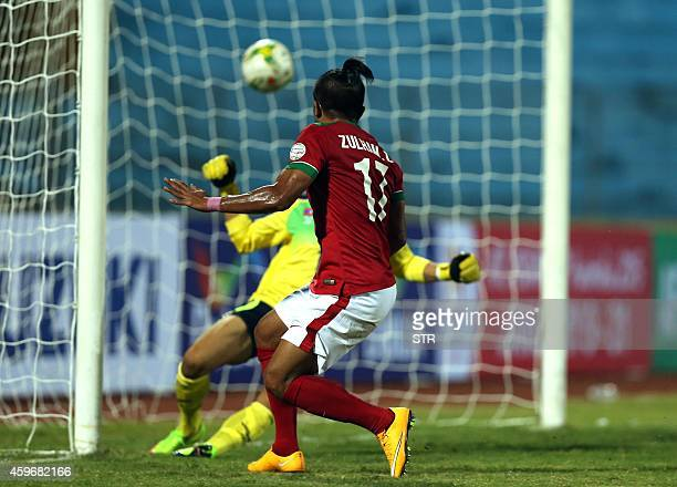 Indonesia's Malik Zamrun scores a goal during an AFF Suzuki Cup match against Laos at Hanoi's Hang Day stadium on November 28 2014 Indonesia won 51...