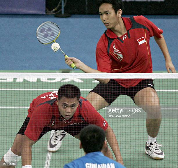 Indonesia's mens doubles pair Markis Kido and Hendra Setiawan return a shot against doubles pair Indonesian Candra Wijaya and US shuttler Tony...