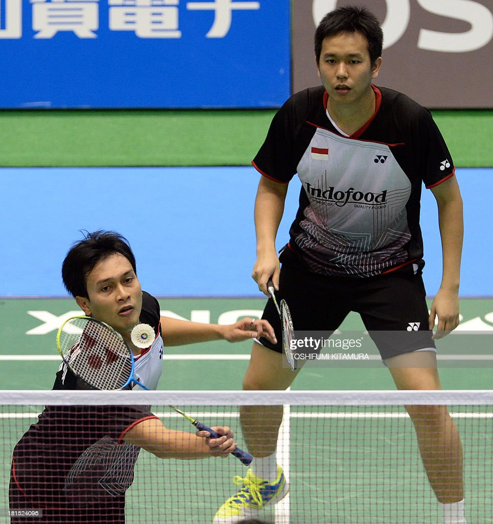 Indonesia s Mohammad Ahsan L hits a return while partner Hendra