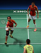 Indonesia's Nitya Krishinda Maheswari hits a return as teammate Greysia Polii looks on during their women's doubles final against China's Bao Yixin...