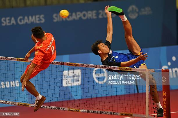 Indonesia's Nofrisal Nofrisal competes with Thailand's Sinwat Sakha during the men's team sepak takraw match at the 28th Southeast Asian Games in...