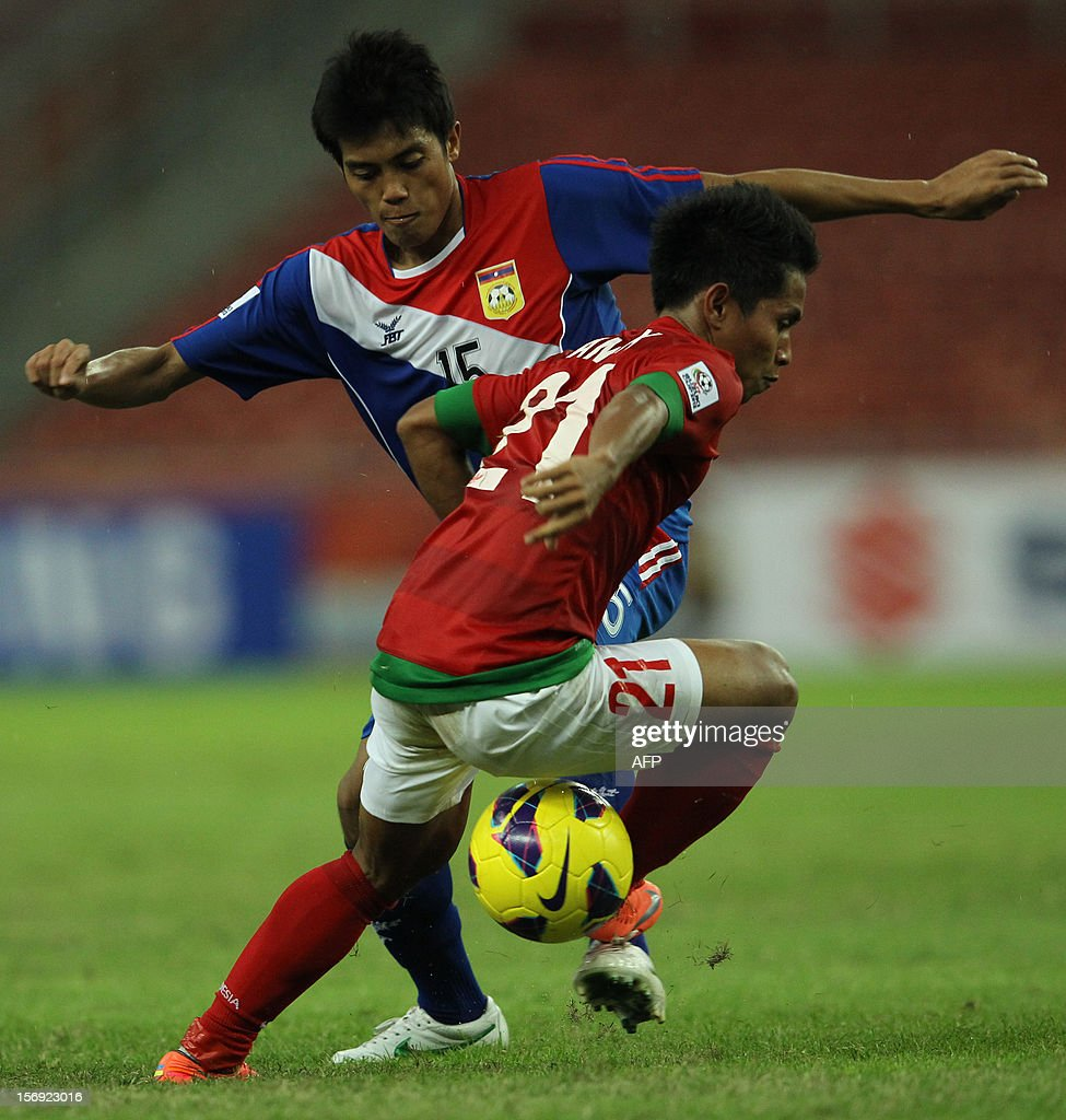 Indonesia's player Andik Vermansah (R) fights for the ball with Laos's player Viengsavanh Sayyaboun during their AFF Suzuki Cup group B football match in Bukit Jalil Stadium outside Kuala Lumpur on November 25, 2012.