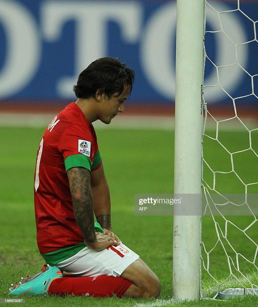 Indonesia's player Irfan Haarys Bachdim reacts after missing a goal against Laos during their AFF Suzuki Cup group B football match in Bukit Jalil Stadium outside Kuala Lumpur on November 25, 2012.