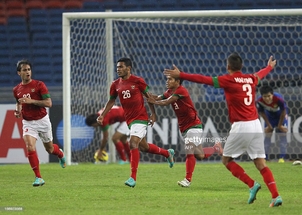 Indonesia's player Vendry Ronaldo Mofu (2nd L) celebrates a goal with teammates against Laos during their AFF Suzuki Cup group B football match in Bukit Jalil Stadium outside Kuala Lumpur on November 25, 2012. Indonesia draw 2-2 against Laos.