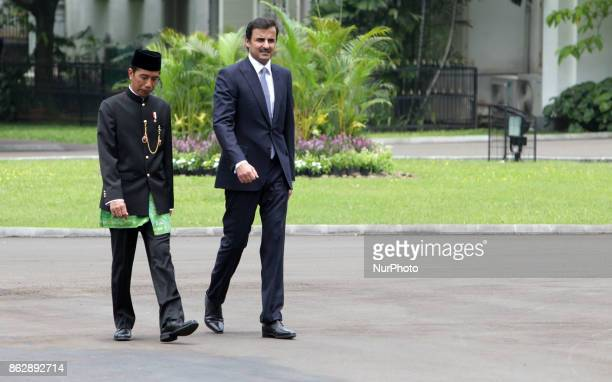 Indonesia's President Joko Widodo and Emir of Qatar Tamim bin Hamad alThani R attend a welcome ceremony by presidential honorary guard at the...