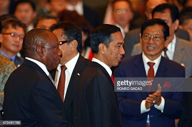 Indonesia's President Joko Widodo and South Africa's Deputy President Cyril Ramaphosa arrive during the AsianAfrican Business Conference in Jakarta...