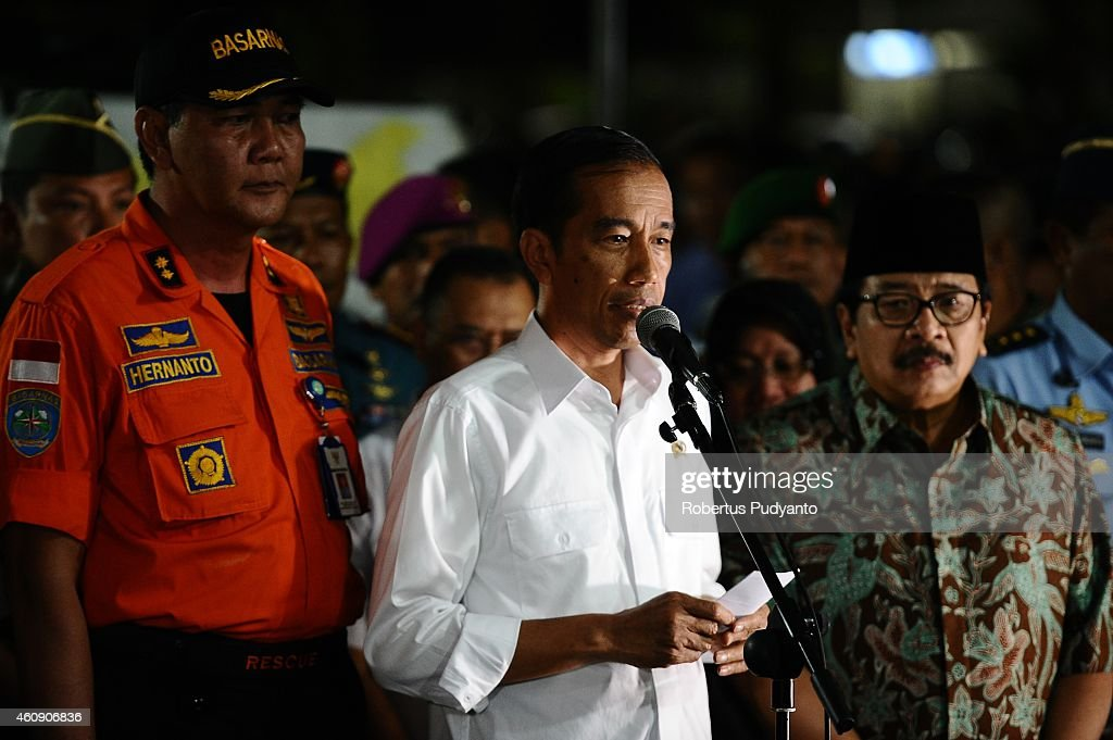 Indonesia's President Joko Widodo (C) speaks during press conference at AirAsia crisis center Juanda International Airport on December 30, 2014 in Surabaya, Indonesia. Indonesian officials have confirmed that debris and dead bodies that have been sighted in the Java Sea are from the AirAsia flight QZ8501 that went missing on Sunday.