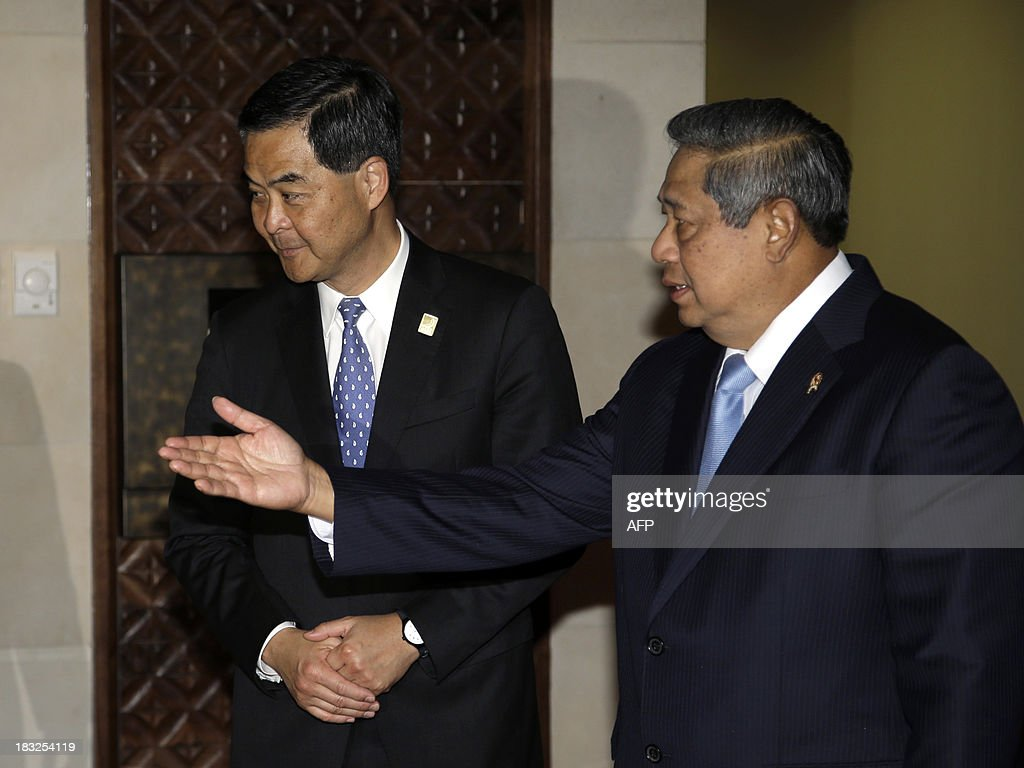 Indonesia's President Susilo Bambang Yudhoyono (R) gestures to Hong Kong Chief Executive Leung Chun-ying (L) shortly before a bilateral meeting on the sidelines of the Asia-Pacific Economic Cooperation (APEC) Summit in Nusa Dua on the Indonesian resort island of Bali on October 6, 2013. Leaders of the 21-member APEC grouping are arriving in Bali ahead of the leader's summit on October 7-8.