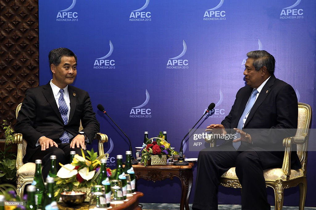 Indonesia's President Susilo Bambang Yudhoyono (R) speaks to Hong Kong Chief Executive Leung Chun-ying (L) during their bilateral meeting on the sidelines of the Asia-Pacific Economic Cooperation (APEC) Summit in Nusa Dua on the Indonesian resort island of Bali on October 6, 2013. Leaders of the 21-member APEC grouping are arriving in Bali ahead of the leader's summit on October 7-8.