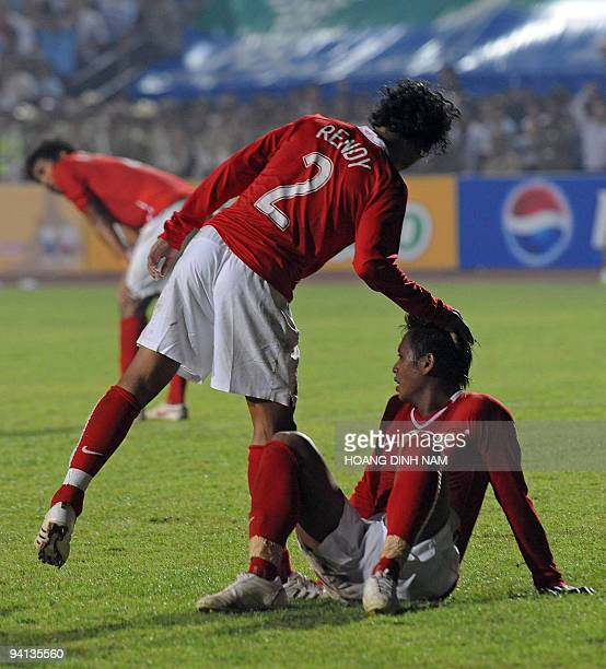 Indonesia's Rendy comforts his teammates after Laos scored a goal during their preliminary match at the 25th Southeast Asia Games in Vientiane on...
