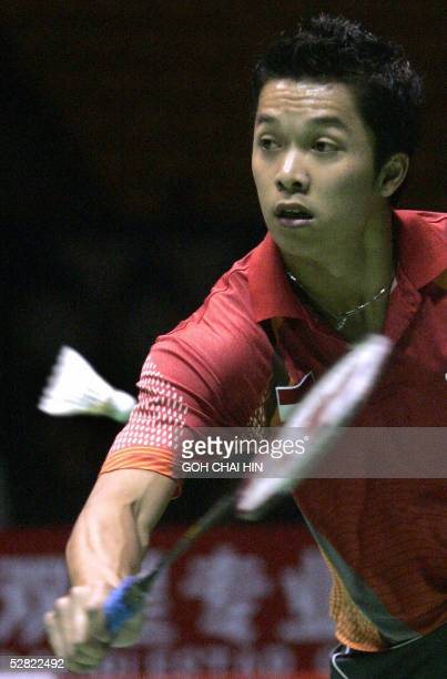 Indonesia's Taufik Hidayat retrieves a shot against Denmark's Peter Gade in the men's singles match semifinal of the Sudirman Cup mixed team...
