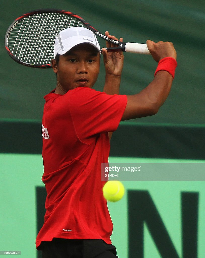 Indonesia's Wishnu Adi Nugroho plays a shot against India's Yuki Bhambri during the Asia/Oceania Zone Group I Davis Cup singles play-off match at KSLTA stadium in Bangalore on April 7, 2013.