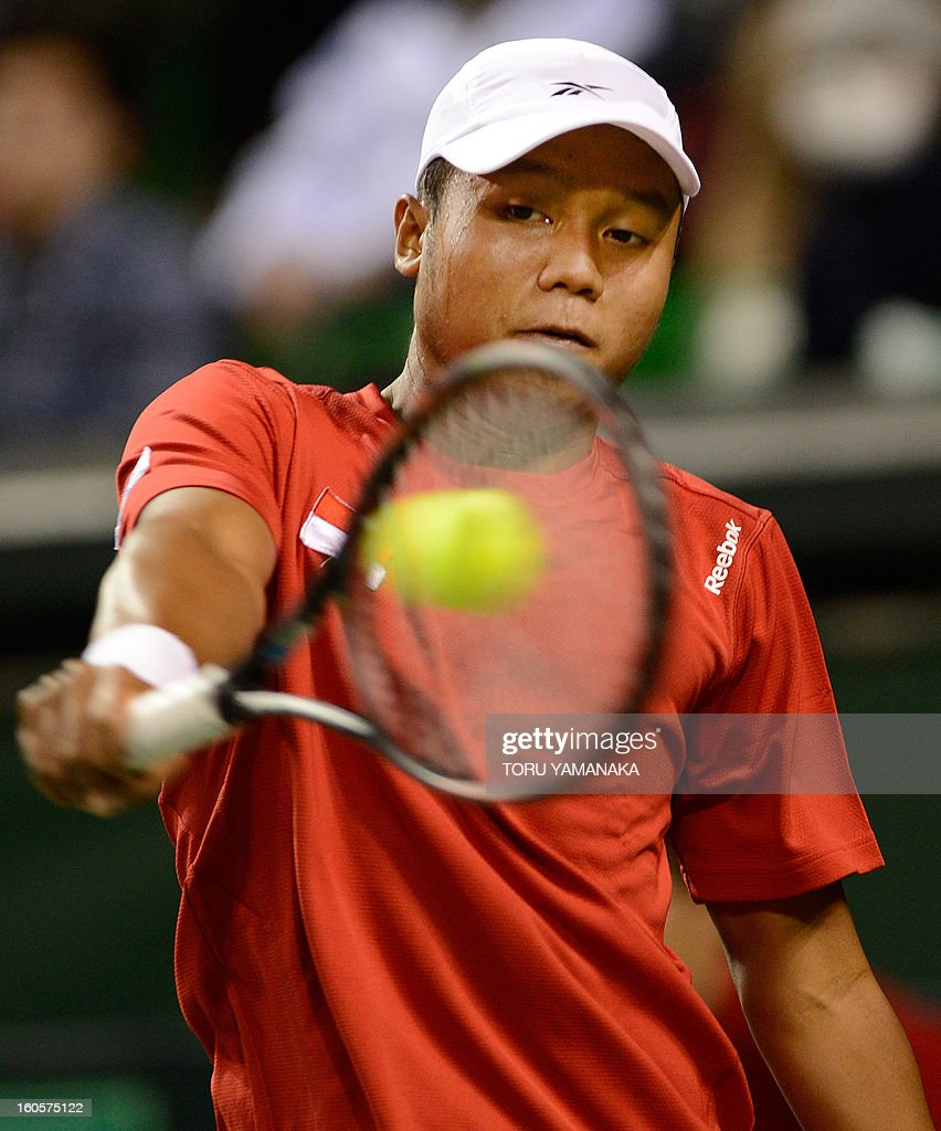 Indonesia's Wisnu Adi Nugroho returns a shot against Japan's Yasutaka Uchiyama during their men's singles match at the Davis Cup Asia-Oceania Zone Group I first-round tie tennis tournament on February 3, 2013. AFP PHOTO/Toru YAMANAKA