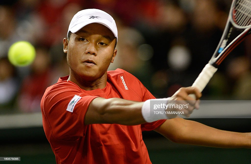 Indonesia's Wisnu Adi Nugroho returns a shot to Japan's Yasutaka Uchiyama during their men's singles match at the Davis Cup Asia-Oceania Zone Group I first-round tie in Tokyo on February 3, 2013. AFP PHOTO/Toru YAMANAKA