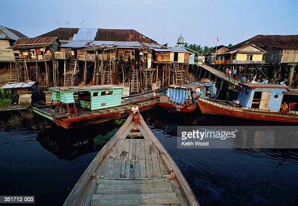 Indonesia,Sumatra,shanty town with houseboats in foreground