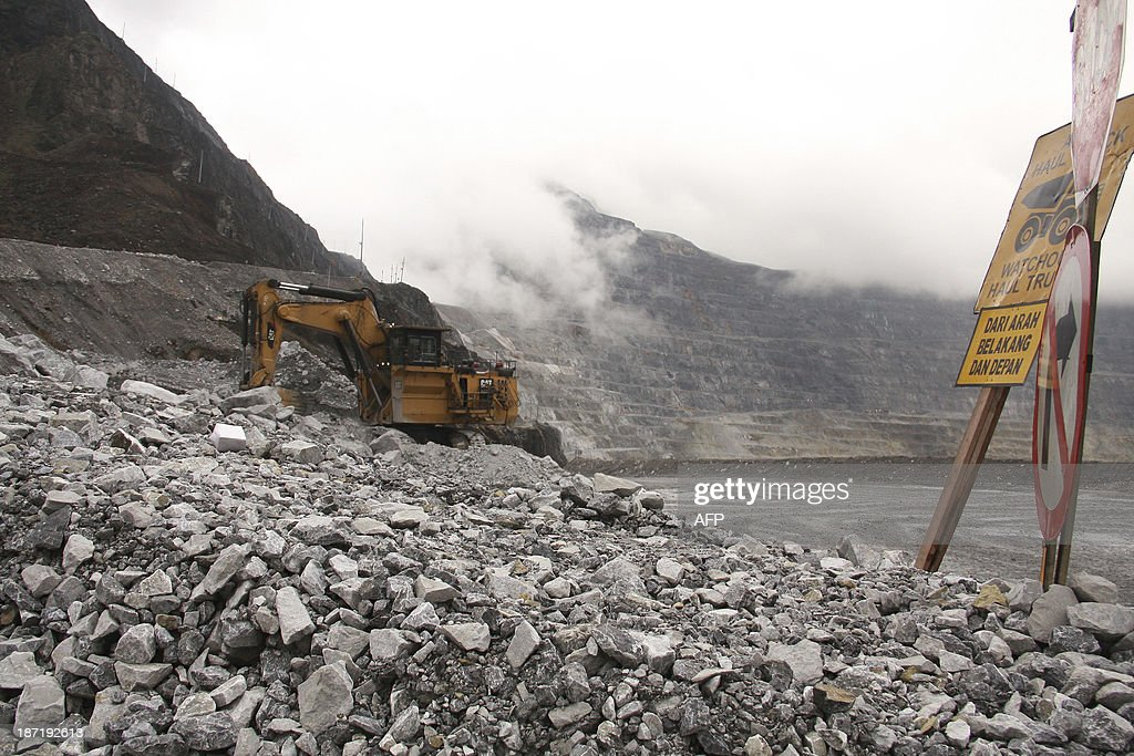 IndonesiaUSminingFreeportFEATURE In this photograph taken on August 16 a heavy machinery vehicle collects rocks with ore deposits at the Freeport...
