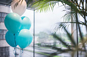 Background photo of ballons set for celebration at the office.
