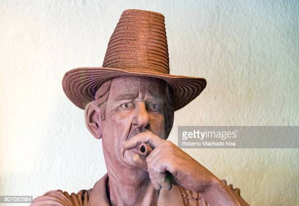 Indoor details of the Bello Family's Cigar Factory Face of sculpture statue of Mr Bello senior He is smoking a Cuban cigar