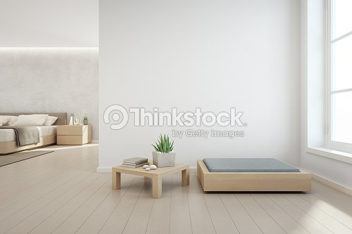 Indoor plant on wooden coffee table and modern furniture with empty white concrete wall background, Bedroom near living room in scandinavian house : Stock Photo