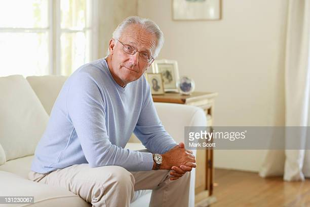 Indoor portrait of a 60 year man looking at camera