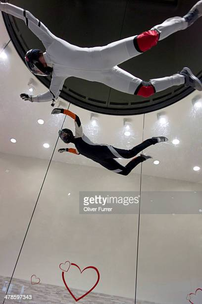 Indoor skydivers practising the freefall scenario