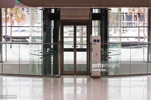Indoors entry of modern office building with glass walls