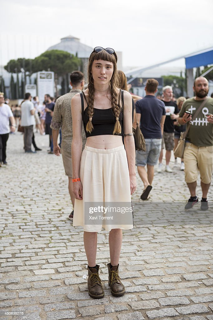 Indra is wearing a second hand skirt, a top from H&M, boots from Dr.Martens and sunglasses from H&M at the Sonar Music Festival on June 14, 2014 in Barcelona, Spain.