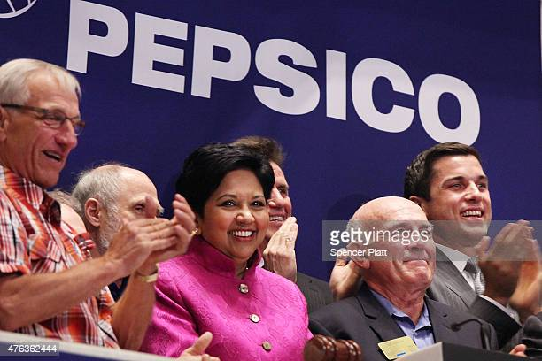 Indra K Nooyi Chairman and Chief Executive Officer of PepsiCo rings the Opening Bell with other executives at the New York Stock Exchange on June 8...