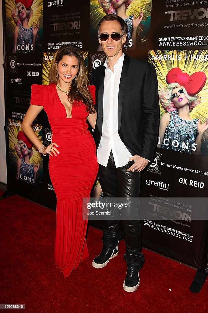 Indrani and Markus Klinko arrive at Markus + Indrani Icons book launch party hosted by Carmen Electra benefiting The Trevor Project at Merry Karnowsky Gallery & Graffiti on January 10, 2013 in Los Angeles, California.