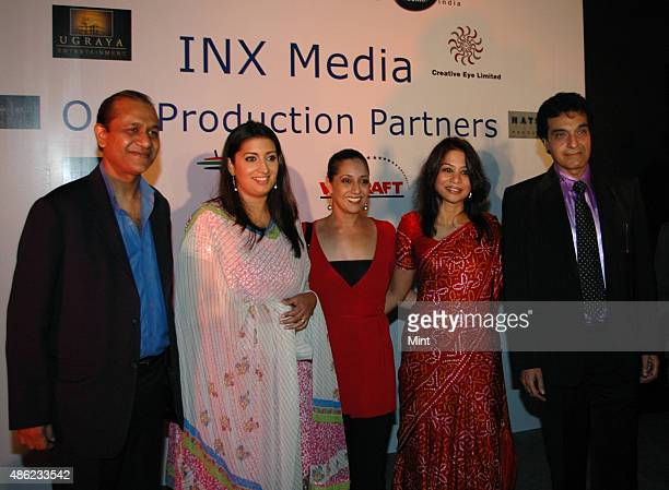 Indrani Mukerjea Founder CEO INX Media Pvt Ltd with television actor Smriti Irani and Dheeraj Kumar during a press conference of INX Media Press...