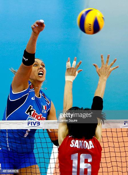 Indre Sorokaite of Italy spikes the ball as Saori Sakoda of Japan defends during the final round match against Italy on day 4 of the FIVB Volleyball...