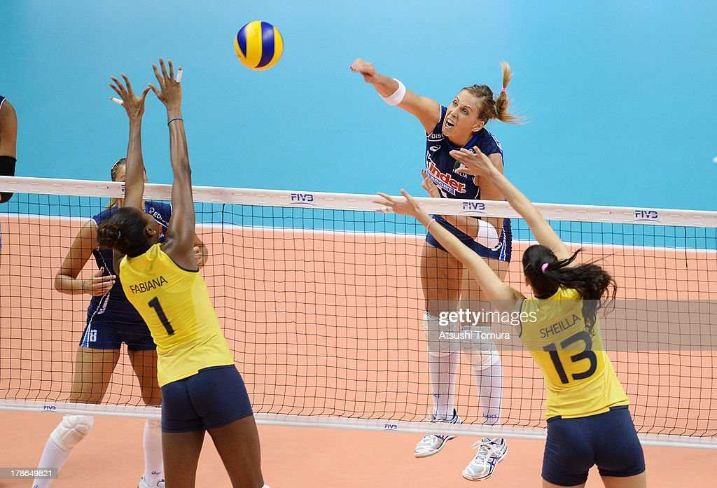 Indre Sorokaite of Italy spikes the ball during day three of the FIVB World Grand Prix Sapporo 2013 match between Brazil and Italy at Hokkaido Prefectural Sports Center on August 30, 2013 in Sapporo, Hokkaido, Japan.