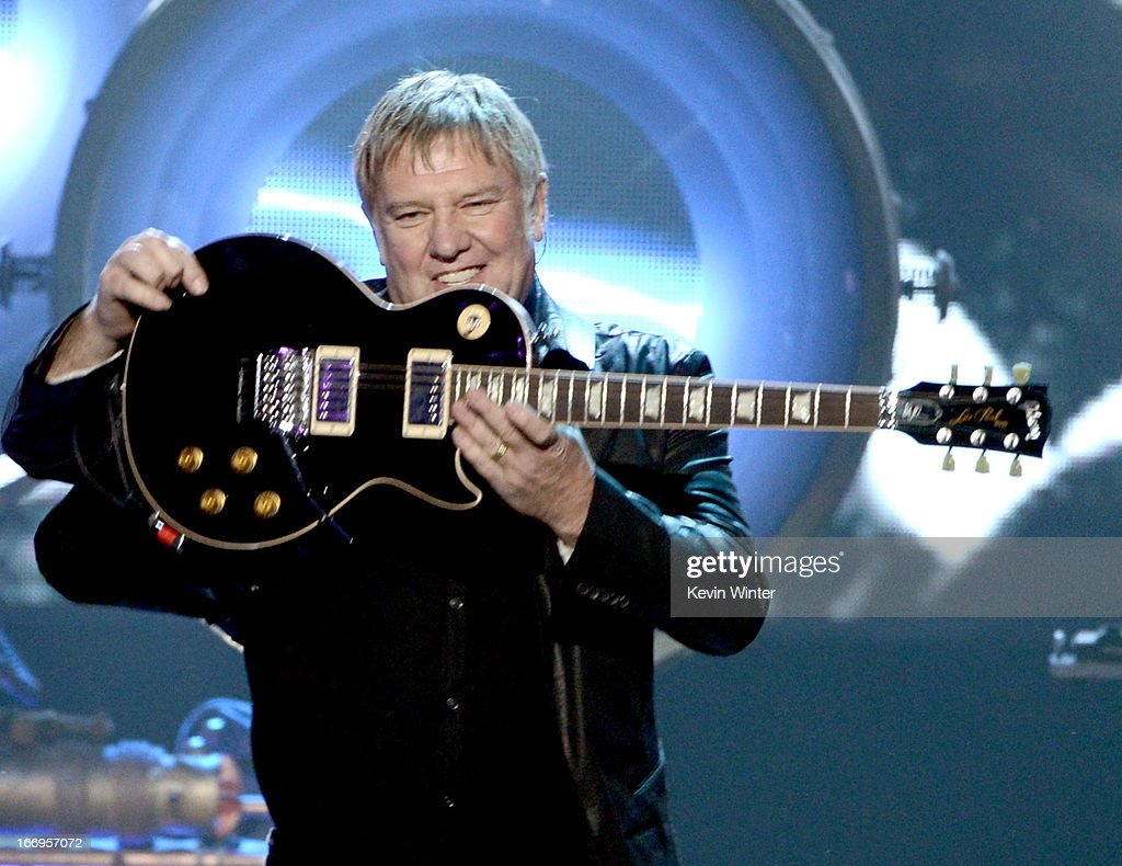 Inductee <a gi-track='captionPersonalityLinkClicked' href=/galleries/search?phrase=Alex+Lifeson&family=editorial&specificpeople=228149 ng-click='$event.stopPropagation()'>Alex Lifeson</a> of Rush performs onstage at the 28th Annual Rock and Roll Hall of Fame Induction Ceremony at Nokia Theatre L.A. Live on April 18, 2013 in Los Angeles, California.