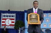 2010 inductee Andre Dawson poses for a photograph with his plaque at Clark Sports Center during the Baseball Hall of Fame induction ceremony on July...