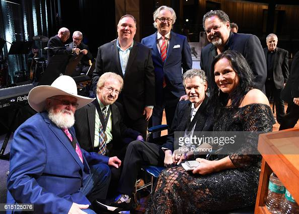 Inductee Charlie Daniels Duane Allen of The Oak Ridge Boys inductee Randy Travis and his wife Mary Davis Tony Conway Kyle Young and Kurt Webster pose...