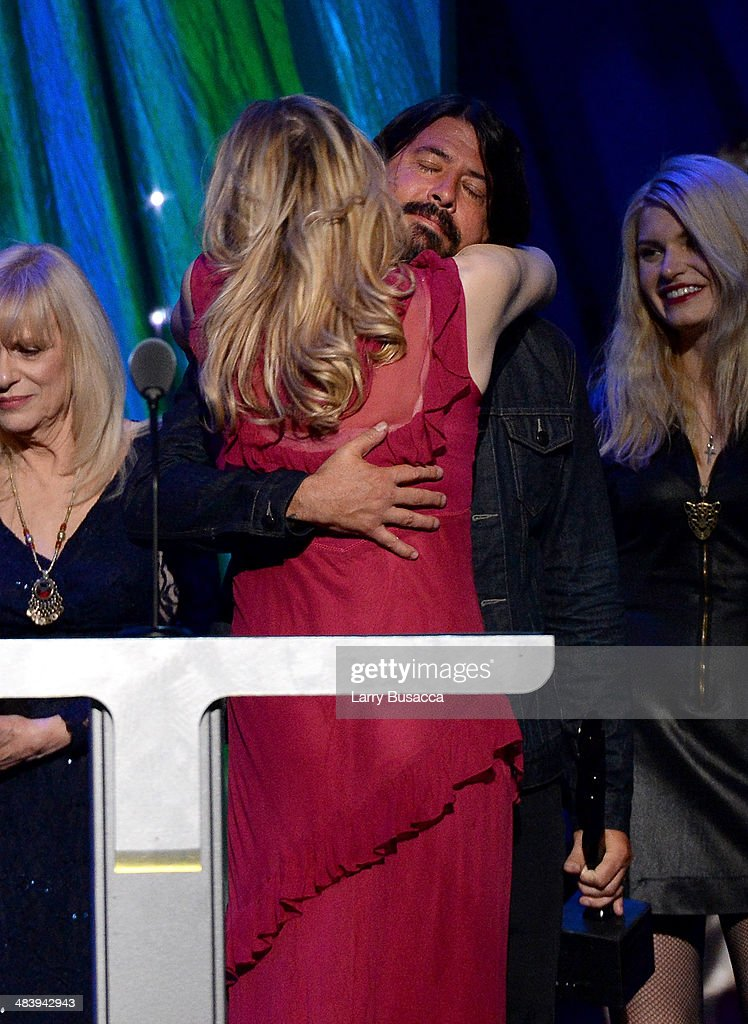 Inductee <a gi-track='captionPersonalityLinkClicked' href=/galleries/search?phrase=Dave+Grohl&family=editorial&specificpeople=202539 ng-click='$event.stopPropagation()'>Dave Grohl</a> and Courtney Love pose onstage at the 29th Annual Rock And Roll Hall Of Fame Induction Ceremony at Barclays Center of Brooklyn on April 10, 2014 in New York City.