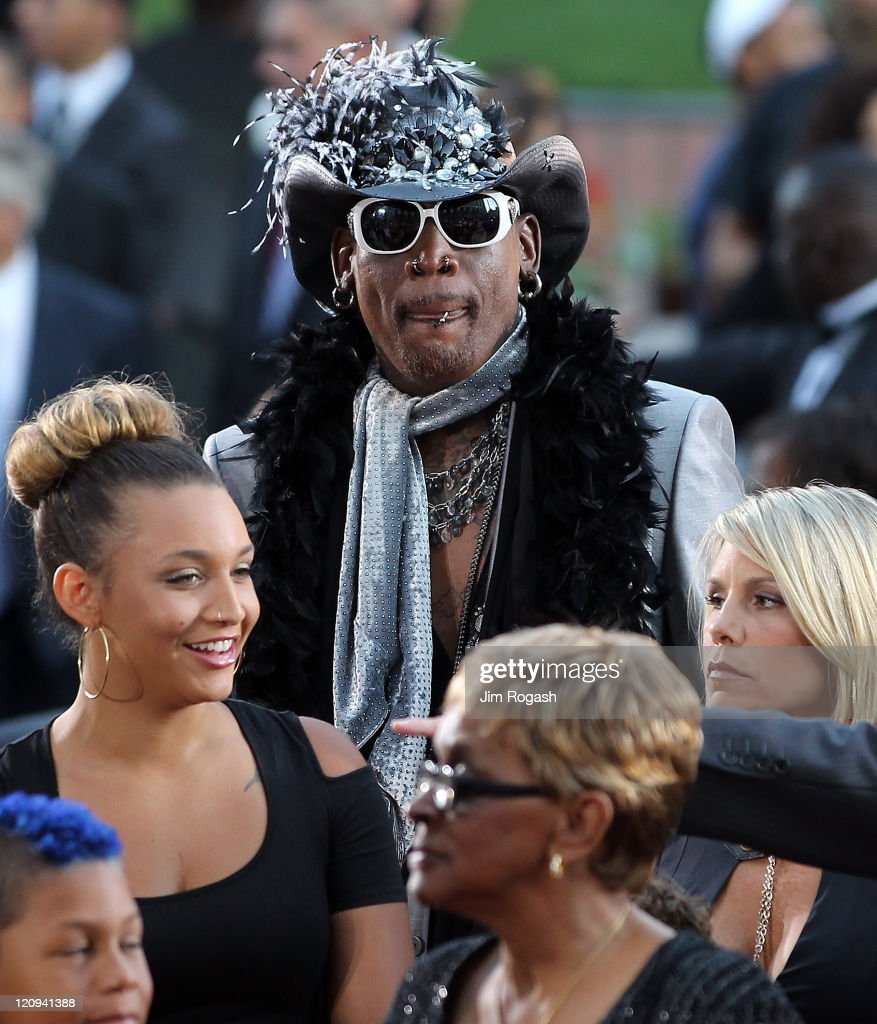 Inductee Dennis Rodman arrives to the Basketball Hall of Fame Enshrinement Ceremony on August 12 2011 at Symphony Hall in Springfield Massachusetts