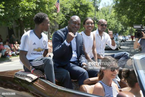 Inductee Evander Holyfield is seen with his family as they ride in the 'Parade of Champions' during the International Boxing Hall of Fame induction...